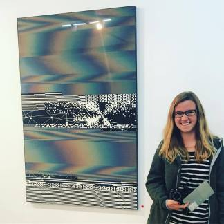 Laura Sellers Bio Image in front of Felipe Pantone NYC 2017